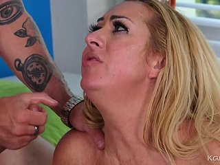 Busty mature makes love with tattooed boy on a catch vis-